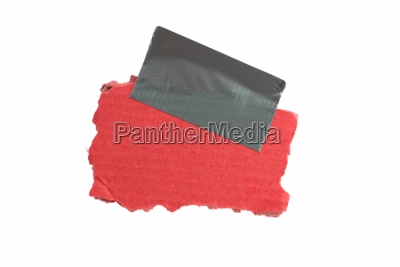 red piece of cardboard with adhesive