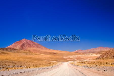 sandy and gravel desert road through