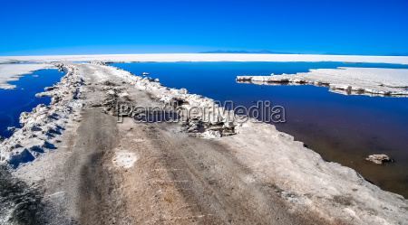 road through the salar de uyuni