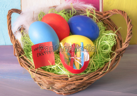 easter basket and eggshell with rolled