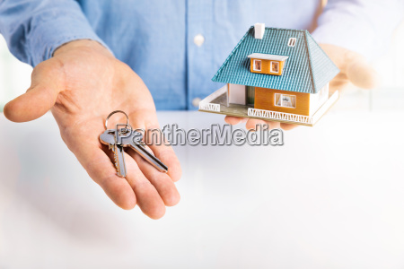 real estate agent with house model