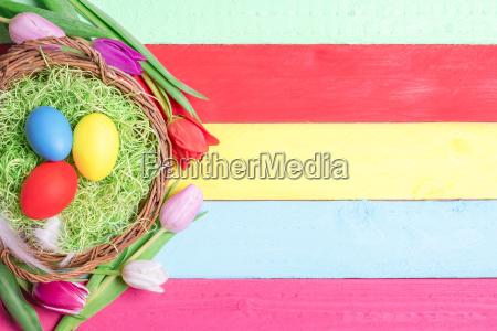 painted eggs in a basket and