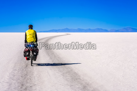 cyclist travelling through the salar de