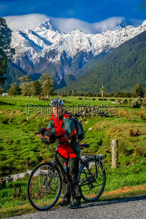 cycling in front of mount cook