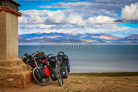 two cycle touring loaded bicycles on