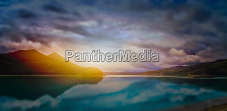 sunset over calm waters of a