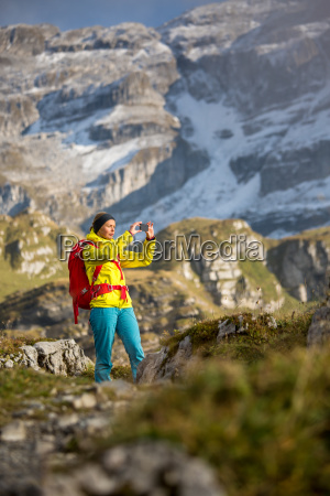 pretty young female hiker walking in