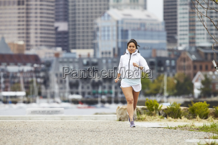 a woman running in east boston