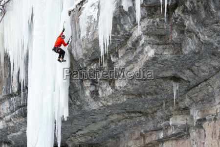 side view of man climbing on