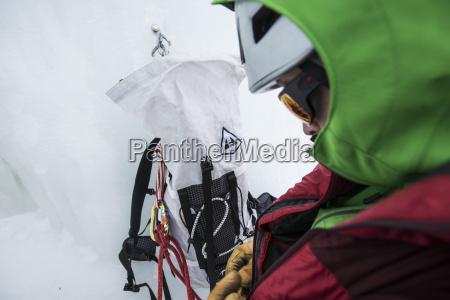 climber preparing before ice climbing in