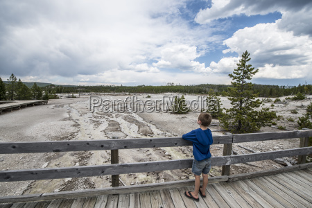 boy looking at view of lower