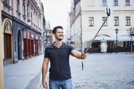 man taking selfie during holidays in