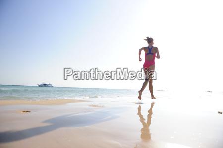 egypt soma bay woman running on