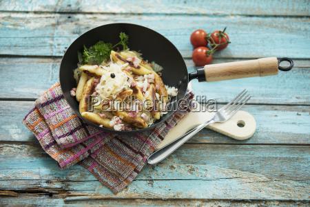 frying pan of finger shaped potato
