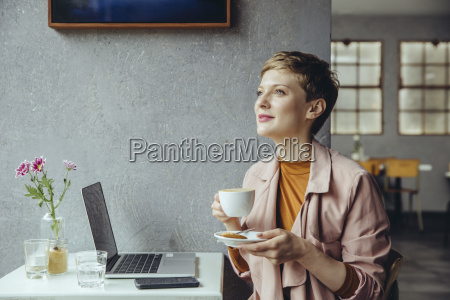 woman with her laptop enjoying a