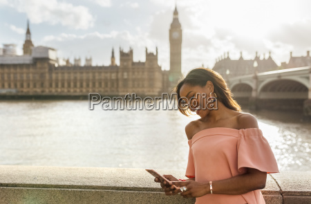 uk london woman sending messages with