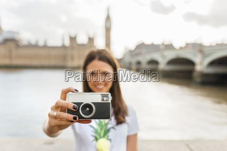 uk london woman holding old fashioned