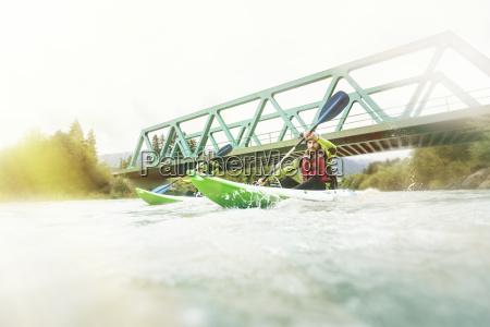 germany bavaria allgaeu couple kayaking on