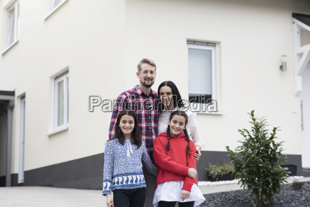 portrait of parents and twin daughters