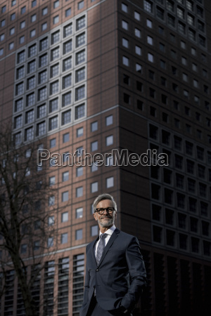 grey haired businessman in front of