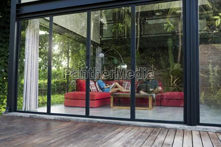 garden view through glass facade of