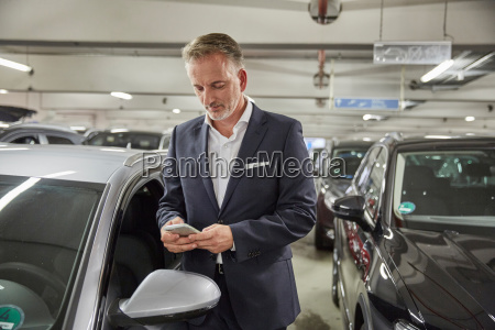 businessman parking his car at the