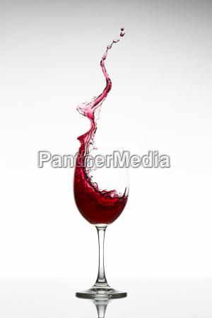 13 red wine splashing out of