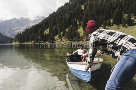austria tyrol alps couple with rowing