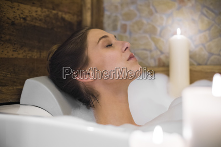 woman taking a bath in candlelight