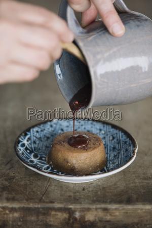 woman preparing dessert partial view