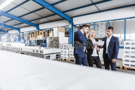three business people discussing on shop