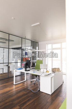 white desk with pc in modern
