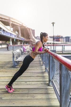 woman doing stretching exercises in manhattan