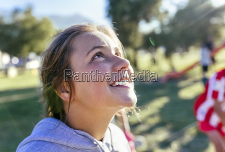 portrait of laughing girl looking up