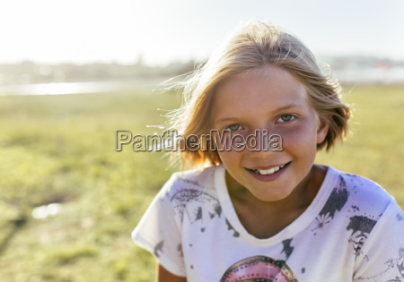 portrait of smiling blond girl at