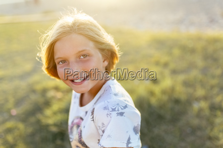 portrait of happy blond girl at