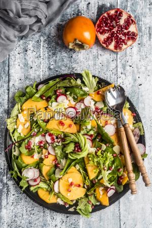 kaki salad with red radish pomegranate