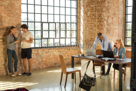 young business people in office preparing