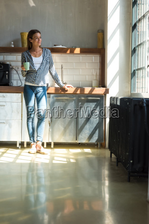 young woman entrepreneur standing in company