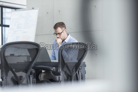 businessman using laptop in office conference