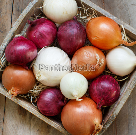 raw onions in basket