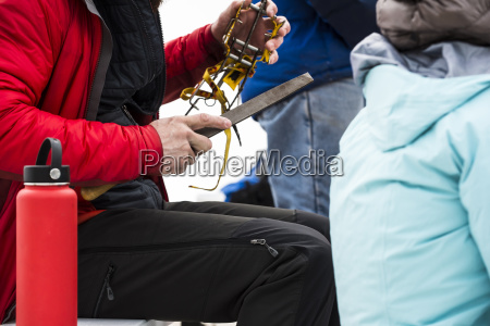 ice climber sharpening crampons ouray ice