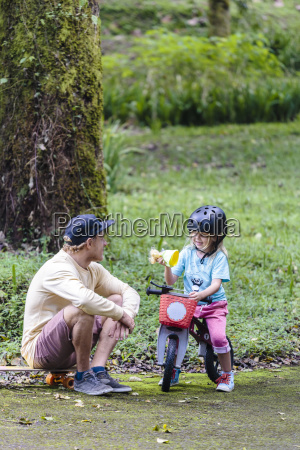 father and daughter with bike in