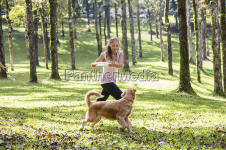 woman playing with her dog in