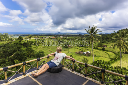 clouds over young man relaxing alone