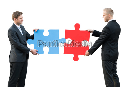 two businesspeople holding blue and red