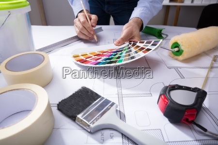 architect using color guide swatch while