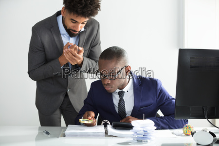 worried man looking at auditor analyzing