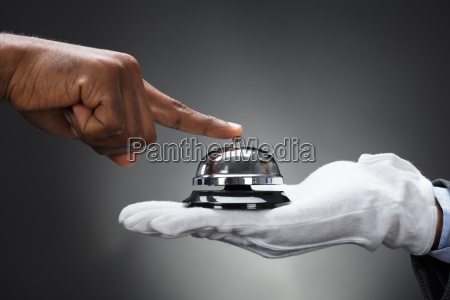 customer ringing service bell held by