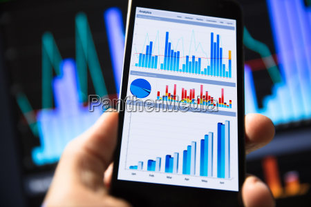 businessperson holding mobile phone